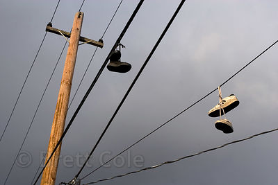 Late light on a power line with two pairs of shoes slung over it, Eugene, Oregon