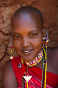 Maasai woman sitting at her hut in the manyatta, Kenya