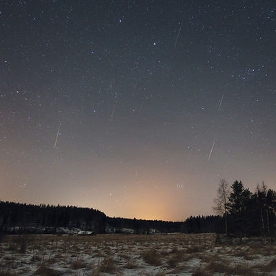 Eight Quadrantid meteors can be seen above the countryside landscape in this composite image taken between 04:58 - 05:17 am, ...