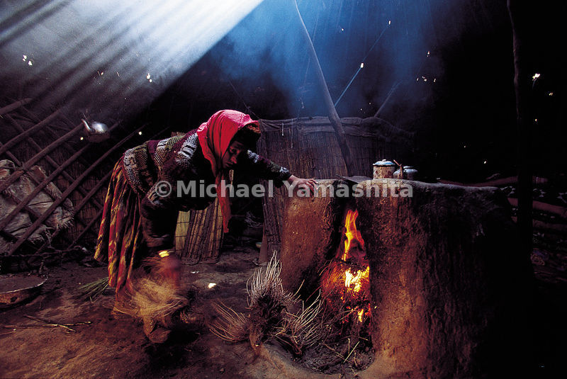 Baking naan (bread) inside a yurt in Datar, a village in the chinese section of the Pamirs.