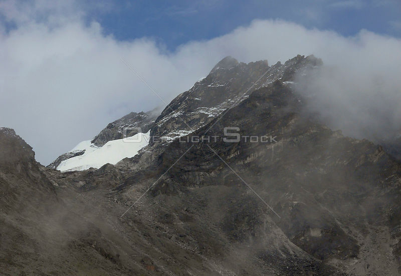 NEPAL Mount Pokalde -- Jul 2007 -- Mount Pokalde (5806m) is featured in this image with parts of the Kongma La (Kongma Pass) ...