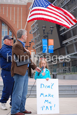 Little girl holding sign at Tea Party protest in Dallas, Texas (American Flag)