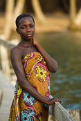 Girl on a walking bridge in the Volta estuary, Ada Foah, Ghana