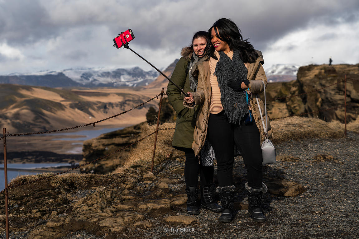 Tourists taking selfies at the southern coast of Iceland near the Dyrhólaey Lighthouse near the town of Vík.