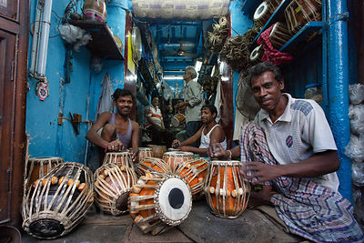 Drum makers work on tablas in Kalighat, Kolkata, India