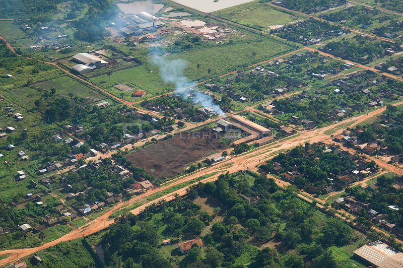 Aerial view of Brazil nut (Bertholletia excelsa) processing plant with large piles of nut shell residue, Riberalta town, Beni...