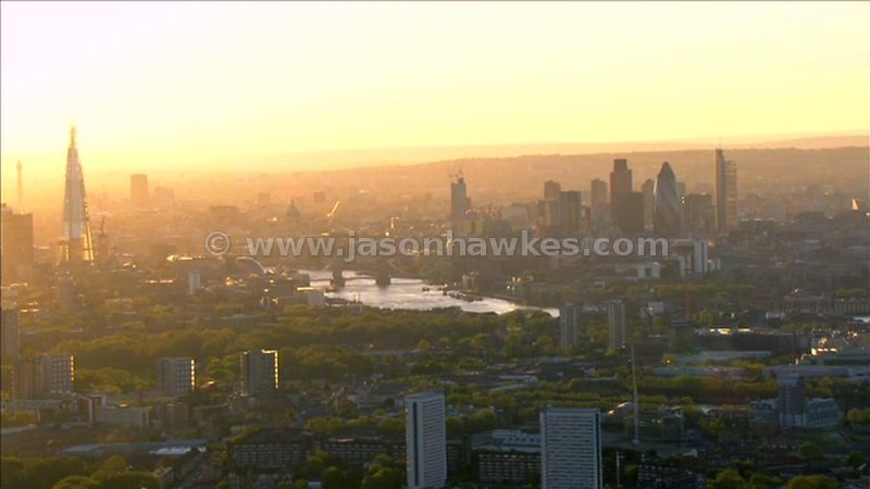 Aerial footage of The Shard, Tower Bridge and the City of London at dusk, London, England
