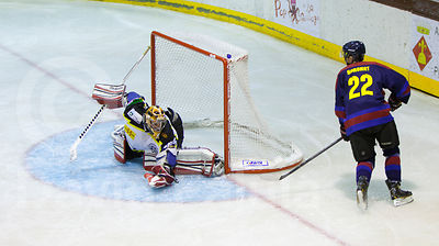 Oriol Boronat (FCB) tries to score against goalkeeper Andrej Beliansky (CGP) during a Spanish Ice Hockey Super League (Superl...