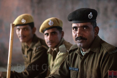 Portrait of three police officers in Pushkar, Rajasthan, India.