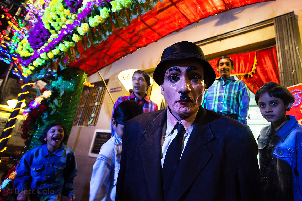 A man dresses like Charlie Chaplin during Christmas in Sovabazar, Kolkata, India.