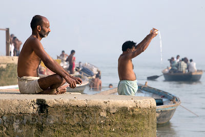 Hindus meditate and pray on the Ganges River, Varanasi, India