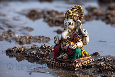 A Ganesh idol washed up on Chowpatty Beach in Mumbai, India after the Ganesh Chaturthi festival. Hundreds of idols are immers...