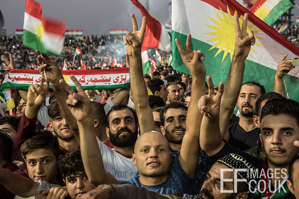 Attendees at the final Kurdish Independence Referendum rally, held at the Franso Hariri Stadium in Erbil, wave flags and rais...