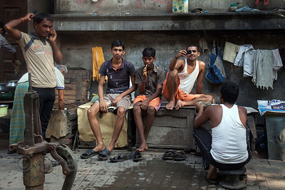 Men hang out on Strand Road in Kolkata, India. The area is a major distribution center for goods throughout Kolkata.