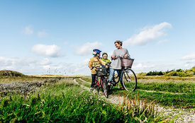 Mother and children biking in Thy, Denmark 6