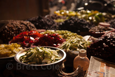 Fantastic assortment of dates, star fruit, and other foods on a cart at a market in Shekwalhi, Mumbai, India.
