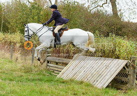 Monica Tebbutt-Wheat jumping a hunt jump near Peake's. The Cottesmore Hunt at Somerby