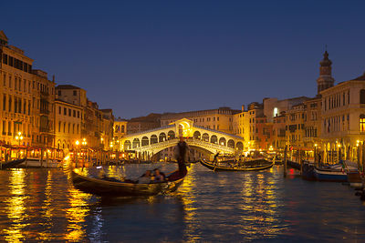 Italy, Venice, View of Grand Canal and Rialto bridge at dusk