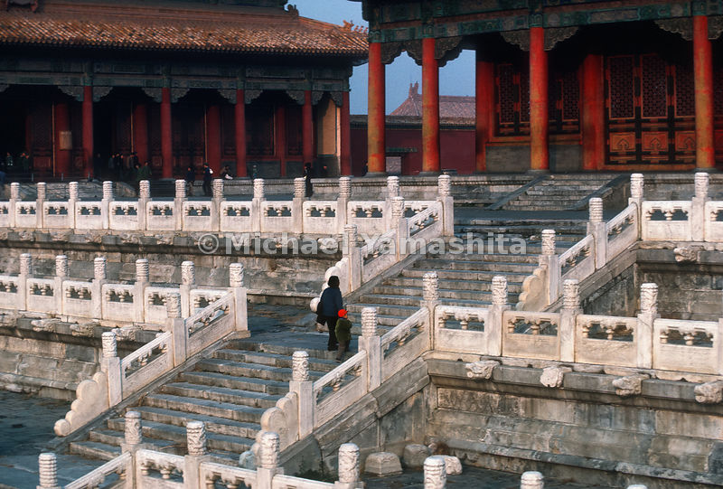 Tourists walk up stairs in the Forbidden City..Beijing, China.