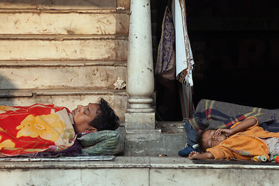 Homeless persons sleep in a stairway, Newmarket, Kolkata, India.
