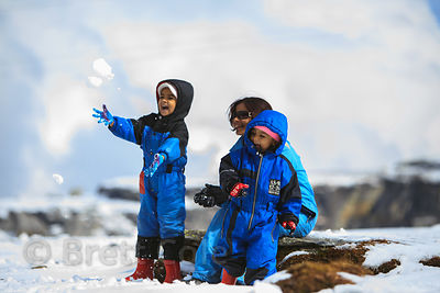 Indian tourists play at Snow Point on the summit of Rohtang Pass, Manali, India