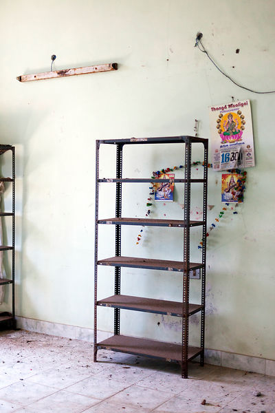 A room with shelving in the derelict Hotel du Ville that has been saved by INTACH (Indian National Trust for Art and Cultural...