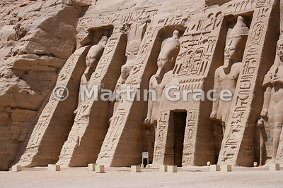 Alternating colossi of Ramesses II and Queen Nefertari on the facade of the Temple of Hathor, Abu Simbel, Egypt, built by Ram...