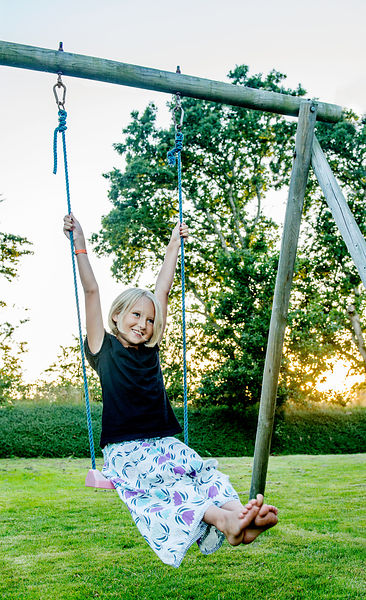 Younger Nordic girl on a swing