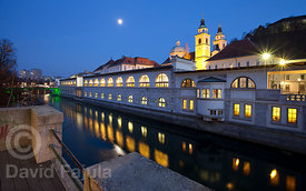Moonrise over the Cathedral of Saint Nicholas (Stolnica svetega Nikolaja) with Ljubljanica river on the foreground & Ljubljan...