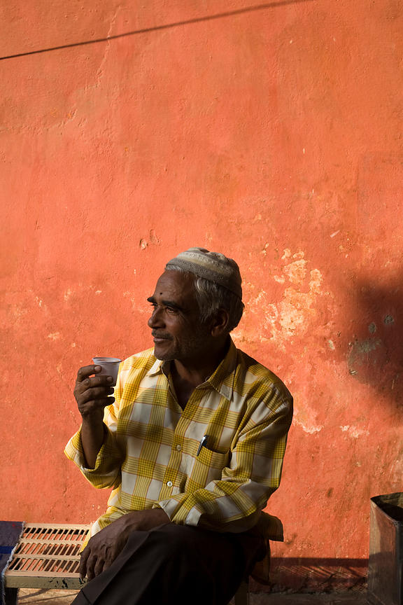 India - Rajasthan - A man drinks tea in a Jaipur bazaar