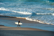 Surfer on the beach, Tofo, Mozambique