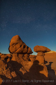 Sandstone Hoodoos Lit by Moonlight In Goblin Valley State Park