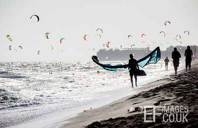 Kite Surfers On The Beach At Mui Ne
