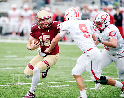 Coe College's Max Ridenour (15) is chased by Central's Tate Jensen (9) and Tyler Olson (2) during the first half of play at C...