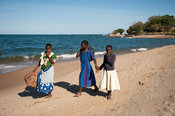 Girls walking on the beach, Chintheche, Malawi