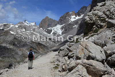 Junction of tracks 1km N of Mirador del Cable, with walker, Picos de Europa, Cantabria, Spain