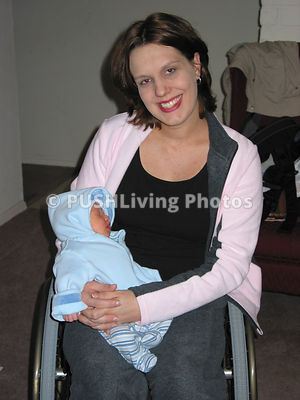 Mother in a wheelchair with her newborn baby