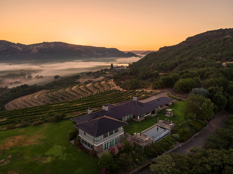 Aerial photography of sunrise over a private estate and winery in Napa Valley. Photography by Jason Tinacci