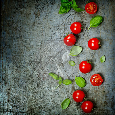 Cherry tomatoes with basil leaves