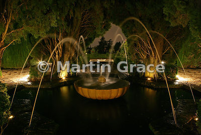 Illuminated fountain in the Generalife Gardens at night, Granada, Andalusia, Spain
