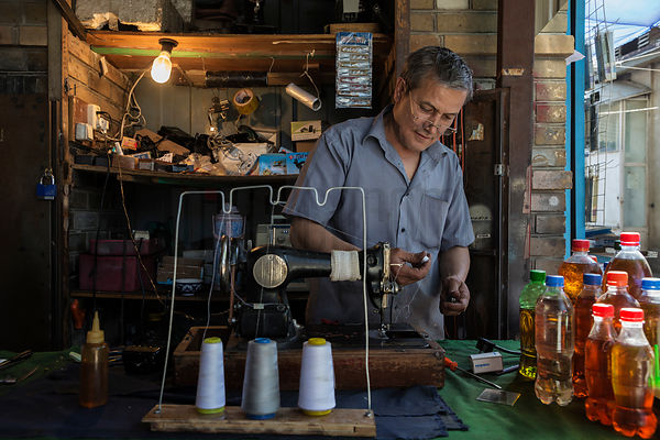 Portrait of a Sewing Machine Repair Dealer