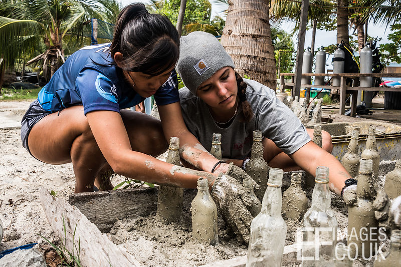 TRACC volunteers cover glass portions of artificial reef structures with concrete to roughen the surface and decrease reflect...