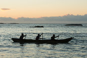 Fishing boat at sea at sunrise, Sainte Luce Bay, Madagascar