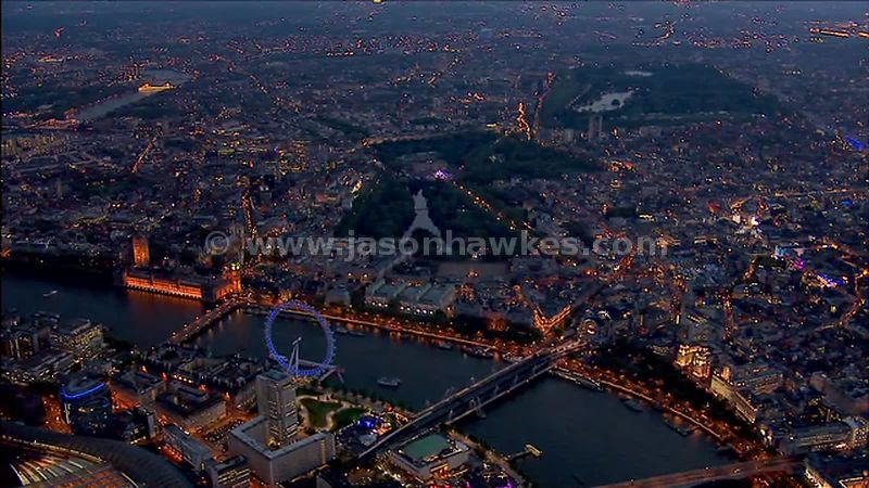 Aerial footage over Buckingham Palace at night, London, England, UK