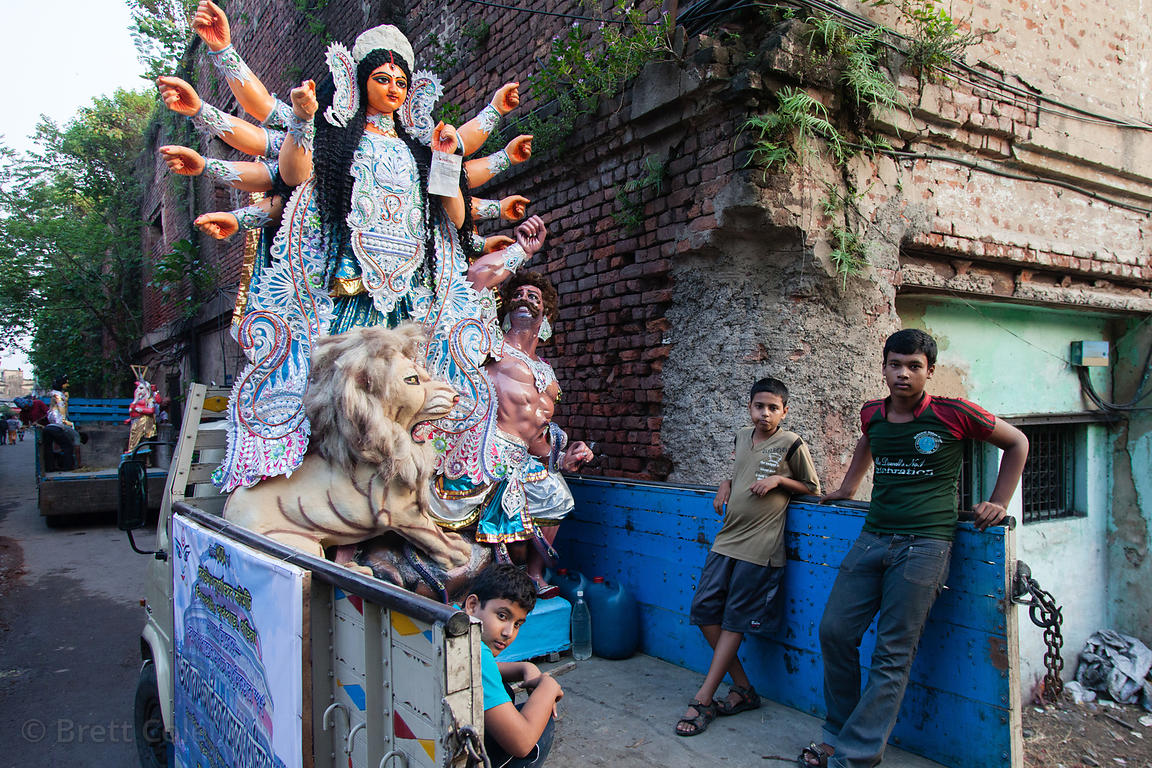 Men load a Durga Puja idol onto a truck in Kumartoli (Potter's Town), Kolkata, India. The idol will be taken to one of the 2,...