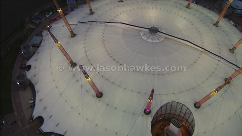 Aerial footage over the O2 Arena at night, North Greenwich, London, UK