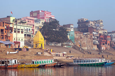Distinctive yellow temple at Kshameshwar Ghat, Varanasi, India.