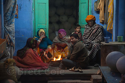 Family of basket makers huddled around a fire for warmth, Jodhpur, Rajasthan, India
