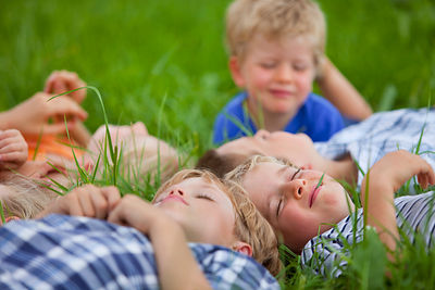 Germanny, Bavaria, Group of children lying in meadow