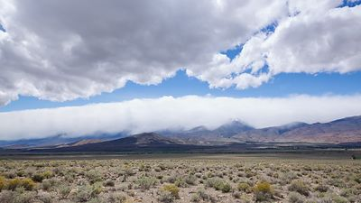Wide Shot: Nimbostratus Clouds Build up at the Bottom of a Weather Trough Between Weather Blocking Mountain Ranges by the Eas...